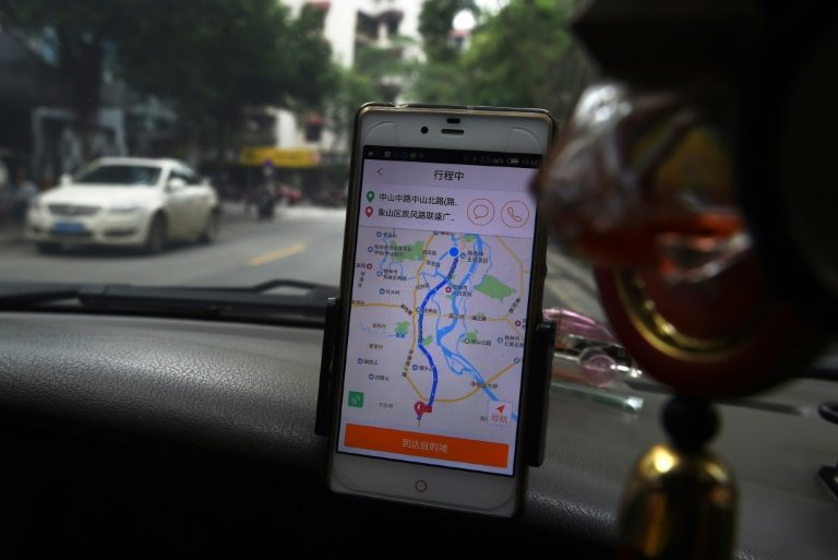 China suspends carpool services following murders