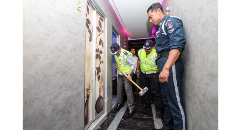 Six massage parlours in KL offering sex services raided
