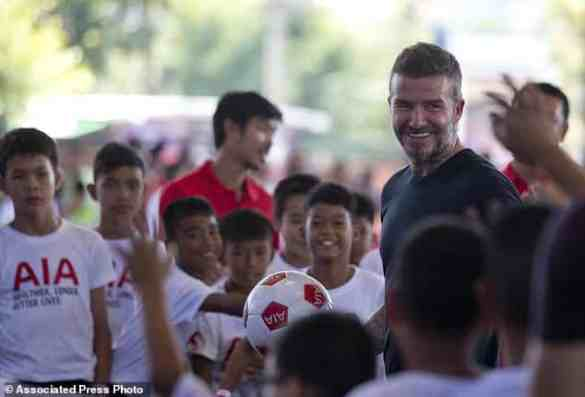 Beckham's Bangkok Soccer Clinic, star flies in to coach Thai kids