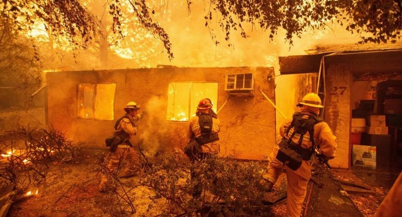 Rescue workers recover bodies in fire-hit California town
