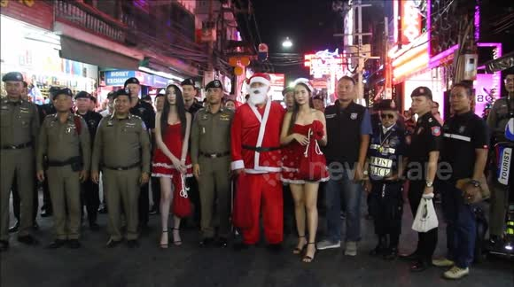 Video: Police, Models & Candy Sticks On Walking Street For Christmas Eve
