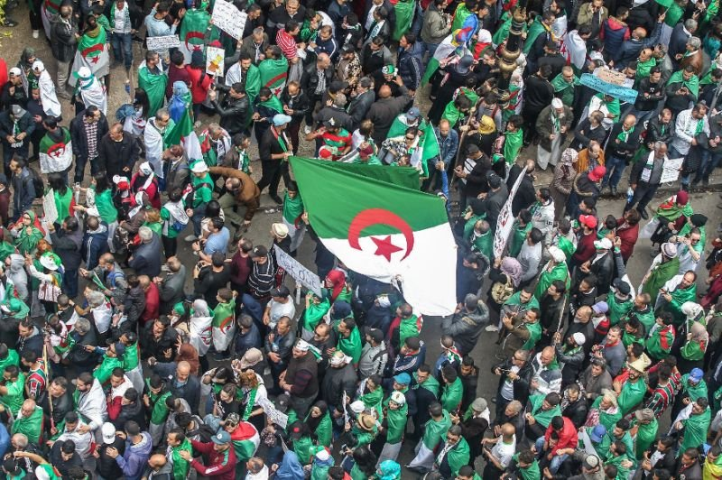 Algerians abroad return home, seeing hope in protest movement