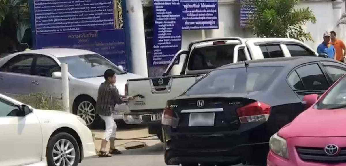 Thai women take AXE to car parked outside their house