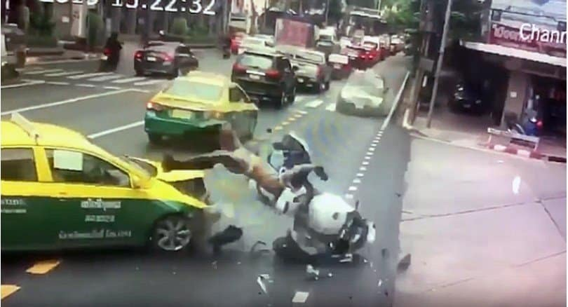 Military escort motorcycle smashes into Bangkok taxi