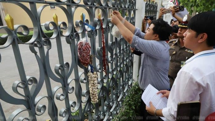 Student Activists Fined for Hanging Chili and Garlic on the Fence of Govt. House