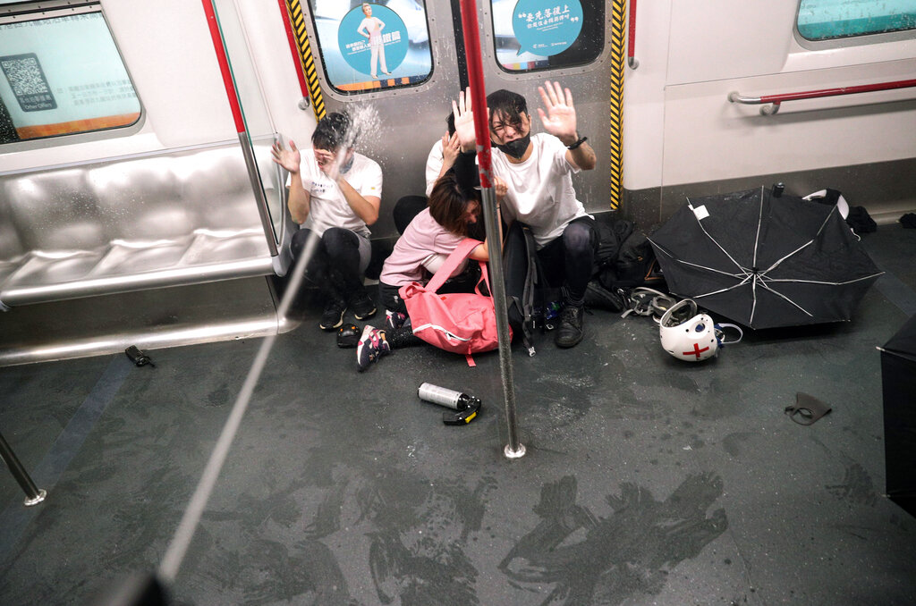 Police shoot pepper spray as they try to detain protesters inside a train at Prince Edward MTR Station, Hong Kong, Saturday, Aug. 31, 2019. Hundreds of people are rallying in an athletic park in central Hong Kong as a 13th-straight weekend of pro-democracy protests gets underway. Photo: Ring Yu / HK01 via AP