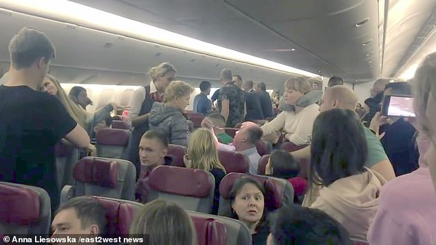 Later, a blazing row between two 'drunk' passengers on the no- alcohol flight from Moscow led to them being forcibly separated (Pictured)