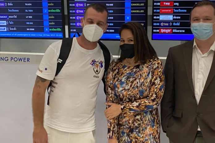 Luke Cook at Bangkok airport with his wife Kanyarat Wechapitak. He arrived in Sydney on Sunday after being acquitted of drug trafficking, for which he was sentenced to death.