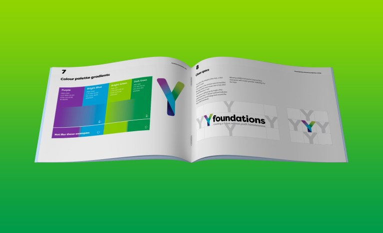 Yfoundations style guide booklet, laying open and showing the new Yfoundations logo and colours.