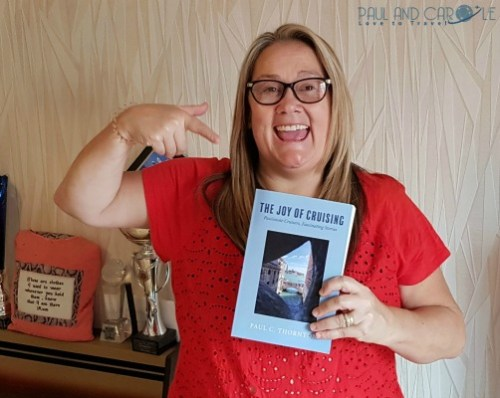 Carole with the book by Paul C Thornton The Joy of Cruising  #paulandcarole2019 #paulcthornton #joyofcruising #travelbooks #cruising #lovecruising