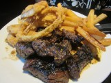 marinated steak tips with french fries and onion rings