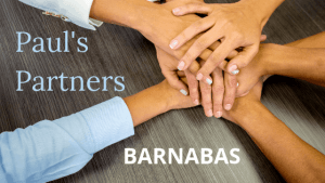 Hands stacked with title Pauls Partners Barnabas