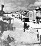Looking north on Front Street (First Avenue) from Cherry St. during the 1880 Big Snow.  Photo by Peterson & Bros