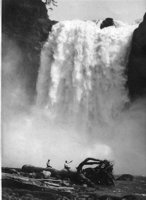 THEN: Snoqualmie Falls appears in full force, probably during a spring runoff.