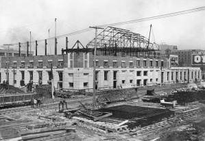 THEN: Looking northwest from the 4th Avenue trestle towards the Great Northern Depot during its early 20th Century construction. (Courtesy, Museum of History and Industry)