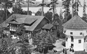 THEN: Above Lake Washington's Union Bay the Hoo-Hoo Building on the left and the Bastion facsimile on the right, were both regional departures from the classical beau arts style, the 1909 AYPE's architectural commonplace. Courtesy John Cooper
