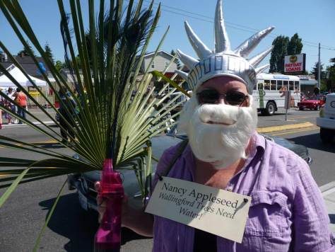 Nancy in white beard and Statue of Liberty cap