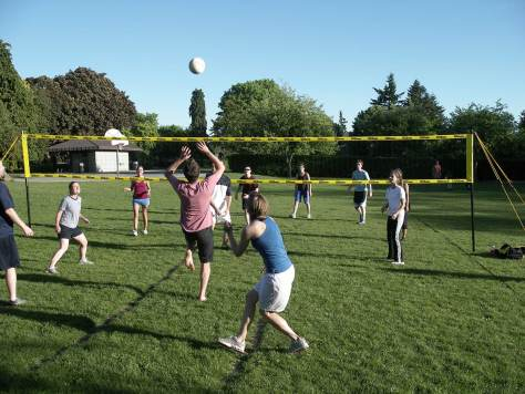 """The contemporary repeat was """"adjusted"""" a few yards to the east to take advantage of this preseason practice by members of the Architects and Engineers Volleyball League.  A few of the old orchard's trees survive along the park's western border with Meridian Avenue, far right. Paul Dorpat"""