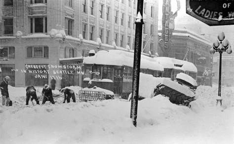 "Looking south on Third between Union and University Streets during the ""big snow of 1916.""  The postcard's own claim that this was ""the greatest snowstorm in history"" is wrong.  It takes second place to Seattle's bigger snow of 1880.  Readers may be now warming up to winter.  We remind you that we have a special ""button"" on this blog for a history of Seattle Snows where the 1880 and 1916 snows, and many others, are described and illustrated. Be prepared."