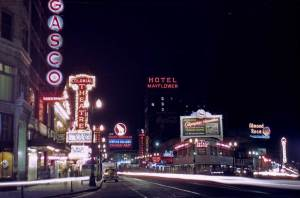 Great railroad signs, theatre signs and ranks of neon were still the greatest contributors to night light at 4th and Westlake in 1949. (Photo by Robert Bradley compliment of Lawton and Jean Gowey)