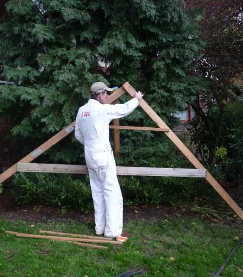 Flip prepares skelton frame for the Forsaken Art Exposition.