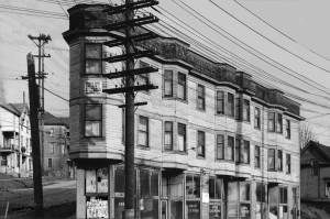 THEN: The Sprague Hotel at 706 Yesler Way was one of many large structures –hotels, apartments and duplexes, built on First Hill to accommodate the housing needs of the city's manic years of grown between its Great Fire in 1889 and the First World War. Photo courtesy Lawton Gowey