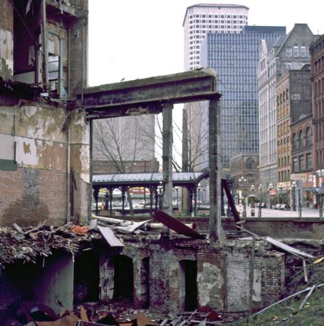 View across Pioneer Square from Olympic Buildilng area. FEb. 7, 1974.  [The collapse secton of the  Olympic block provided for a few months Pioneer Square's own repeat of the romantic passion for classic ruins.]