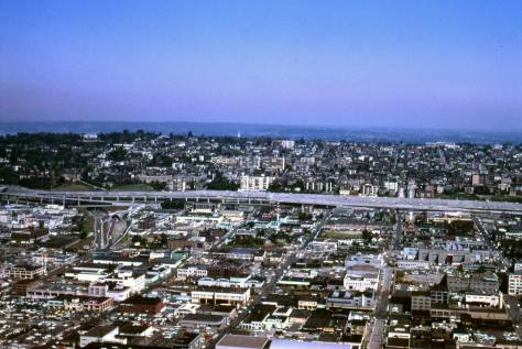 Cascade neighborhood and beyond it freeway construction and Captiol Hill in 1967 as seen from the Space Needle.