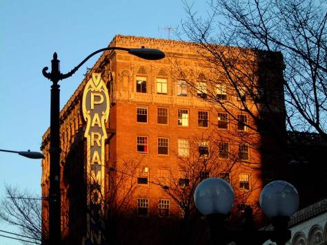 Nine years ago, perhaps, after leaving the library at its temporary quarters on Pike, I took this photograph of the Paramount and its old sign warmed by a late-afternoon winter sunset.  The old sign may be compared to Jean's recent record of the new sign that replaced.  It is just below and part fo the Swedish Baptist insertion.