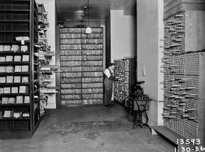 THEN: The clerk in the city's old Engineering Vault attends to its records. Now one of many thousands of images in the Seattle Municipal Archives, this negative is dated Jan. 30, 1936. (Check out www.cityofseattle.net/cityarchives/ to see more.)