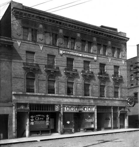 THEN: The Freedman Building on Maynard Avenue was construction soon after the Jackson Street Regrade lowered the neighborhood and dropped Maynard Avenue about two stories to its present grade in Chinatown. (Photo courtesy Lawton Gowey)