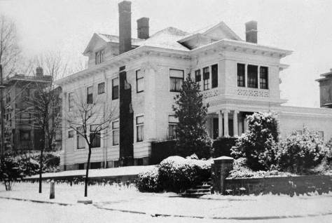 "Emma and George Frye's mansion replaced the water tower.  Not the one-story wing to the far right, attached to the south side of the home.   This addition from the 1920s - the picture was taken in 1925 - was a second ""home"" for their growing collection of genre art, most of it collected in Europe. (Courtesy Frye Museum)"