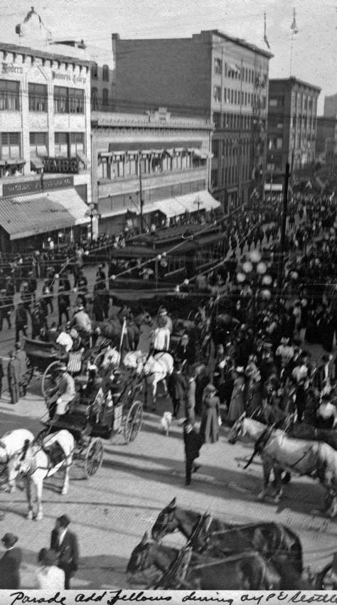 """From nearly the same window, looking south on Second Avenue from its northwest corner with Pine Street and from an upper floor at Standard Furniture, Philip Hughett captioned this view """"the odd fellow's parade."""""""