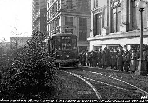 THEN: A Seattle Street and Sewer Department photographer recorded this scene in front of the nearly new City-County Building in 1918. The view looks west from 4th Avenue along a Jefferson Street vacated in this block except for the municipal trolley tracks. (Photo courtesy Seattle Municipal Archive)