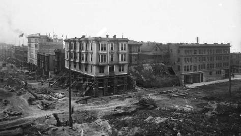 Looking down on Second Avenue and over a roughed-up Pine Street to the Elk hotel on their southwest corner.   Far left is the Eitel Bldge under construction.  Likely date for this is 1905.