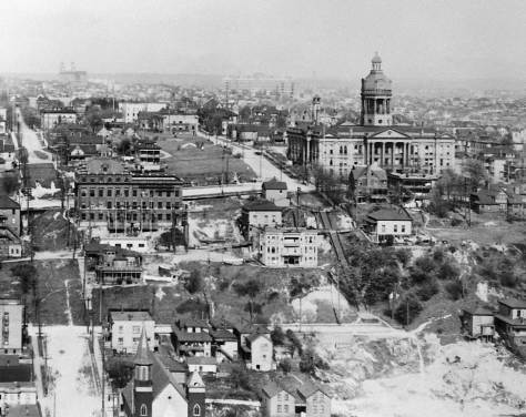 Ca. 1913-14 look to the King County Court House from a new Smith Tower.  Note Our Lady of Good Help Catholic Church steeple lower left at the southeast corner of 5th and Jefferson.   Also the step climbing Terrace to First Hill are seen right-of-center.