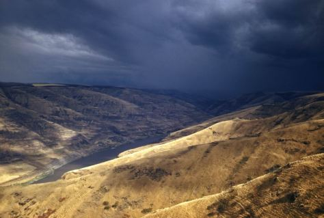 "Horace Sykes has titled this slide ""apporaching storm"" but then leaves it to that.  He does not tell us where or when.  For Sykes and his Kodachromes the when is almost always sometime between WW2 and 1954 the year of his passing.  The ""where"" I'll speculate is somewhere along the Snake River."