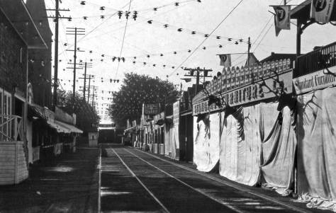 Looking south on 3rd Avenue from Union Street in 1902.  Third north of Universithy and much of Union Street too has been gated for that summer's Elks Carnival.   Part of Plymouth Congregational Church is evident upper-left at University Street.