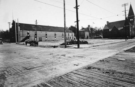 The future Post Office corner has been cleared for construction of - the Post Office.  Date is ca. 1904.  Note the Univesity of Washington up on its Denny Knoll (not hill): the first campus.  Again, the congregationalist and the assorted rifles are right and left respectively  Courtesy Lawton Gowey.