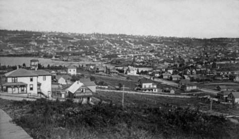 Returning the above look, here from the Queen Anne side, although a few years earlier.  The rough grades climbing capitol hill include Mercer, Republican, Harrison Street and Denny Way.  A small glimpse of First Hill beyond Pike Street is on the far right.