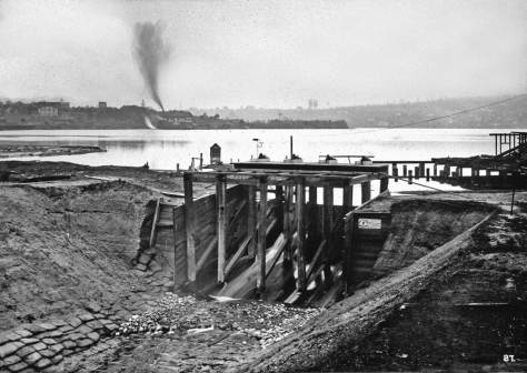 The Fremont dam broke in 1903.  This view of work on the damn and flume is dated 1903, and so most likely after the break.  In some chronologies 1903 is the year that work began - haltingly - on construction of the Lake Washington Ship Canal.
