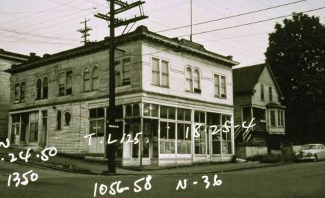 Same corner - Edgewater Hardware in 1950.  Courtesy, Washington State Archive, regional branch - a Tax Photo.