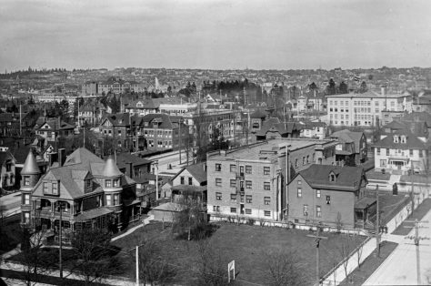Looking northeast from some prospect connected to the then nearly new St. James Cathedral.  On the left is the Ranke home at the southeast corner of Terry and Madison.  Far right is the west facade of the Adrian Court, and a high corner at the rear of the Graystone shows far right.  The horizon is Capitol Hill's.