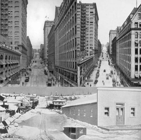 "The three views above all look east on Cherry Street from First Avenue.  The top two variations on the ""Cherry Street Canyon"" circa 1912 after the construction of the Hoge Building at the northwest corner of Second and Cherry and on the left of both the top two view.  For a civic lesson in the growth of a Western American boomtown the top two are compared to the 1880 Snow scene at the bottom. (Yesler's pavilion is far-right, the city's most popular venue for public meetings and entertainment.) By the reckoning of the national census in 1880 Seattle, for the first year, shows a few more residents than were counted in Walla Walla.  Both were less the 4000.  By 1912, Seattle's population was well beyond 200 thousand."