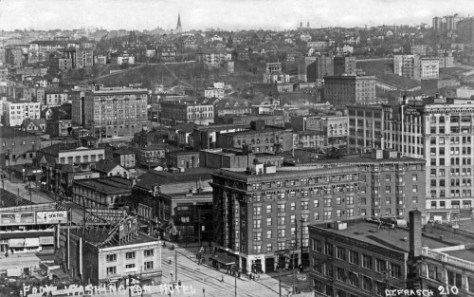 Postcard photographer O.Frasch's look from a new New Washington Hotel at 2nd and Stewart Street to the First Hill horizon north of Madison Street.  For hide-and-seek one may find the Summit School (far right), Waldorf Hotel, the stairs on Union Street from Terry Avenue to 9th Avenue, First Baptist Church (the spire), the three homes described above: Bachus, Margaret & Mary Denny and Orin and Narsissa Denny, and to the right of those the Stimson-Green Mansion; St.Pauls Apartments (at Seneca and Summit - see the detail from the 1912 Baist Map that follows), both the Unitarian church and Dreamland on 7th Ave., Hotel Willard, the Normandie Hotel (with its three winds seen here from the rear), the Van Siclen Apartments on a steep 8th between Seneca and University Streets and, far left, the rear of the Sorrento Hotel.