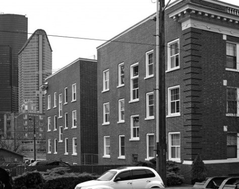 The old First Hill residence was razed in the late 1960s for a parking lot.  The Old Colony Apartments at the southwest corner of Boren and Cherry survive on the right. [Jean Sherrard]