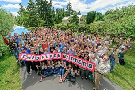"NOW: The ""This Place Matters"" enthusiasm of June 1, last, is wonderfully captured with Jean Sherrard's big lens.  He is not of course as close to the Mukai farm house and garden as is the ""then,"" because of the fence."