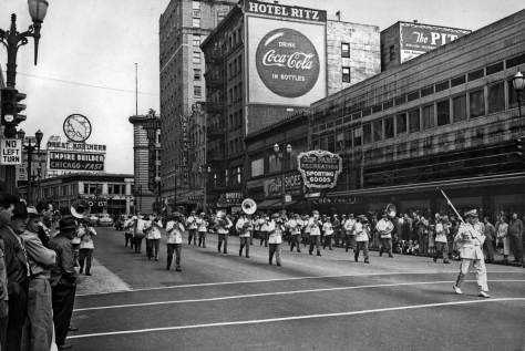 A more traditional parade heading south on 4th and entering its intersection with Pine Street.  Both the Mayflower and the Times Bldg. appears left of center, and another popular center for sportsman and beef-eaters is right-of-center,