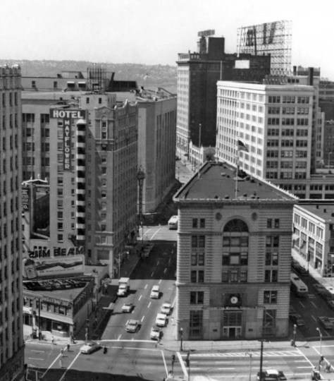 Looking west and back at the featured block with 5th Ave. at the bottom and the Hotel Mayflower across Olive Street from the Times Building.  The sectioned fire escape holding to the hotel's east wall looks very much like the Universal Worm.