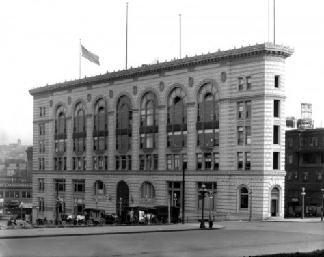 The Times building when nearly new.  The flat-iron terra-cotta beauty is embraced by 5th Avenue to the east and Stewart and Olive, respectively to the north and south.  Across Olive, far right, the Waverly Hotel is still in place.